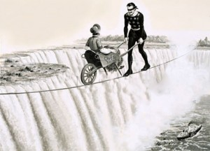 Blondin (Francois Gravelet) pushes a wheelbarrow across a tightrope over Niagra Falls